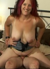 Cock hungry blonde amateur housewife teasingly playing with her shaved twat and big boobs.